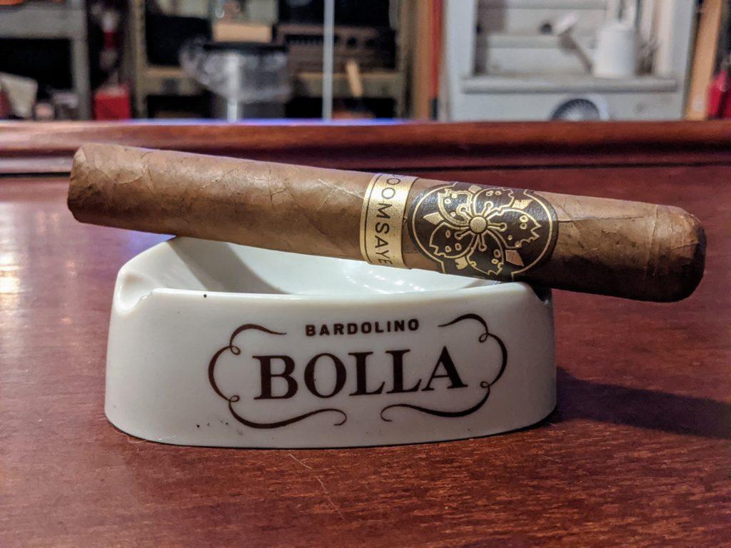 Room101 cigar on a vintage triangular ashtray.